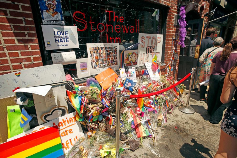 PHOTO: Flowers are laid outside the Stonewall Inn in memorial for Orlando Pulse shooting victims, June 27, 2016, in New York City.