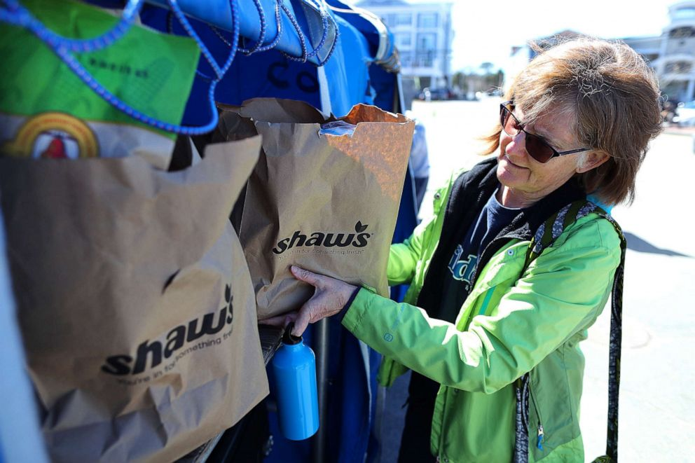 PHOTO: Cindy Whitlock of Washington loads grocery bags from Shaws in Hyannis, Mass., into luggage carts at the Hyannis Ferry Terminal parking lot after shopping for her daughter, Jo, who lives on Nantucket, April 17, 2019.