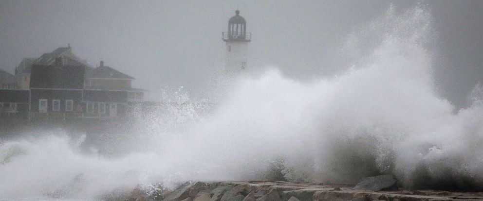 PHOTO: Waves crash against a seawall near the Scituate Lighthouse, March 2, 2018, in Scituate, Mass.