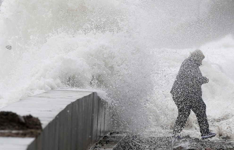 PHOTO: A woman gets caught by a wave as heavy seas continue to come ashore in Wintrhrop, Mass., March 3, 2018.