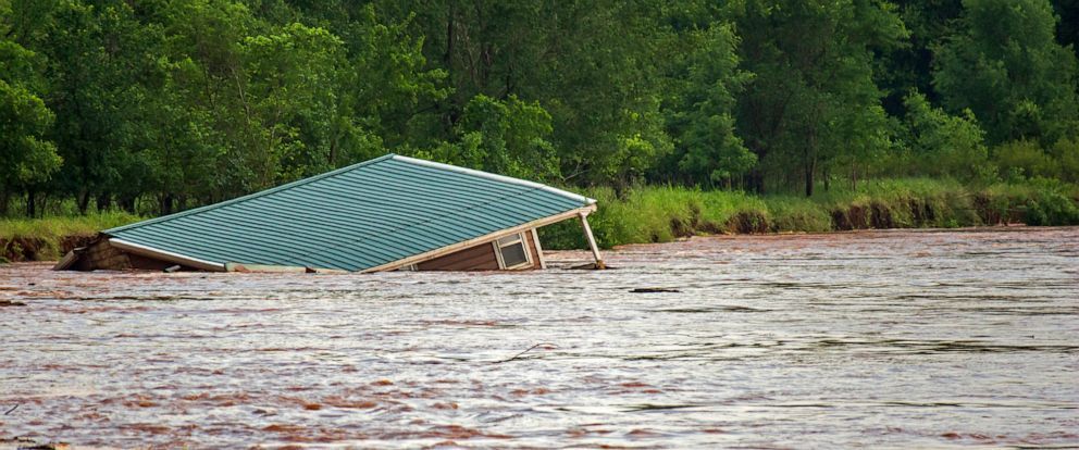 PHOTO: Floodwaters from the Cimarron River wash away a home in the Twin Lakes community near Cimarron City, Okla. on Wednesday, May 22, 2019.