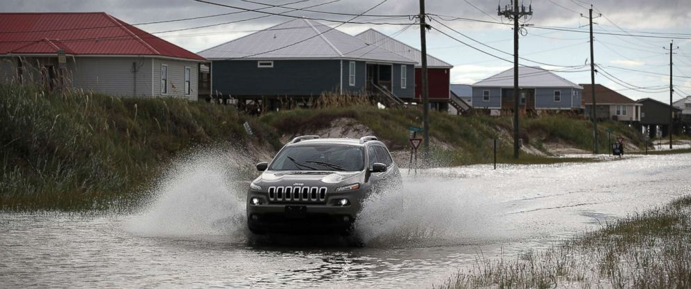 PHOTO: A vehicle drives along a flooded street caused by the approaching Tropical Storm Gordon, Sept. 4, 2018, in Dauphin Island, Alabama.