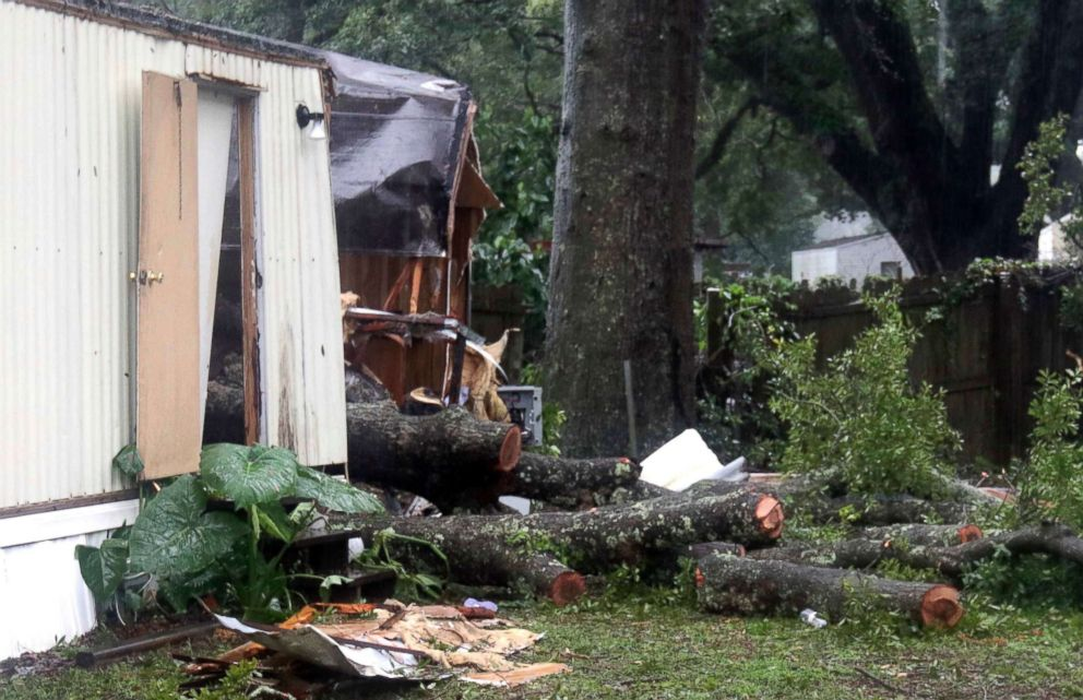 PHOTO: Pieces of an oak tree are seen after it fell on a mobile home in Pensacola, Fla., Sept. 5 2018.