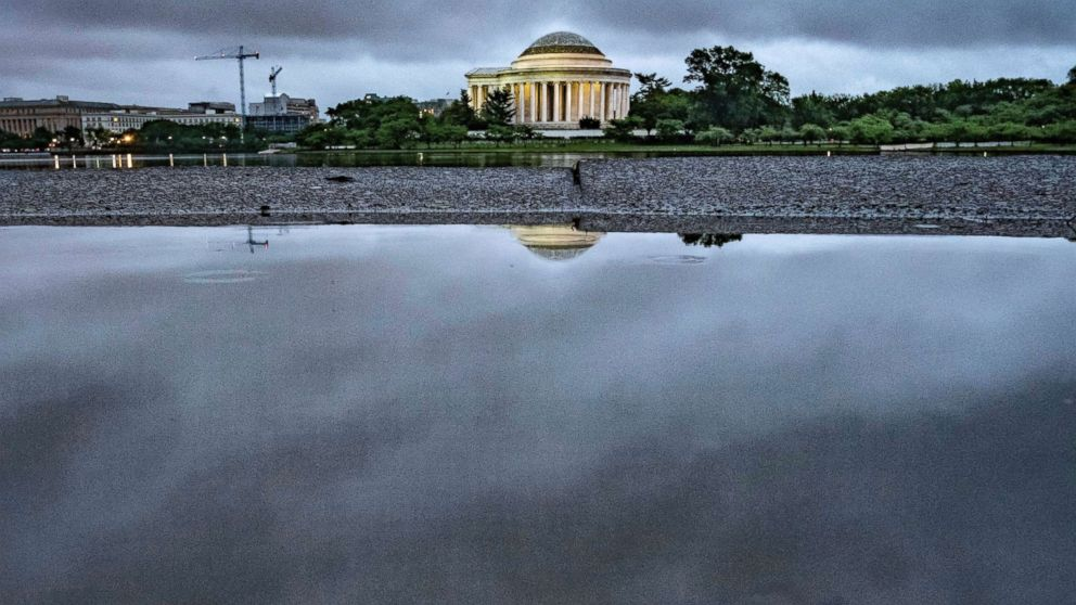 Storm clouds are reflected in a puddle near the Jefferson Memorial in Washington, May 16, 2018. Rain and thunderstorms are expected to continue in the Nation's Capital area for the next couple of day.