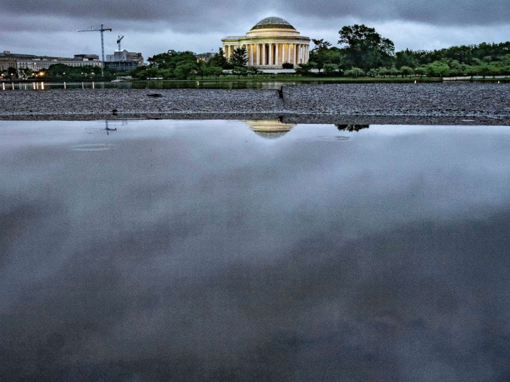 PHOTO: Storm clouds are reflected in a puddle near the Jefferson Memorial in Washington, May 16, 2018. Rain and thunderstorms are expected to continue in the Nations Capital area for the next couple of day.