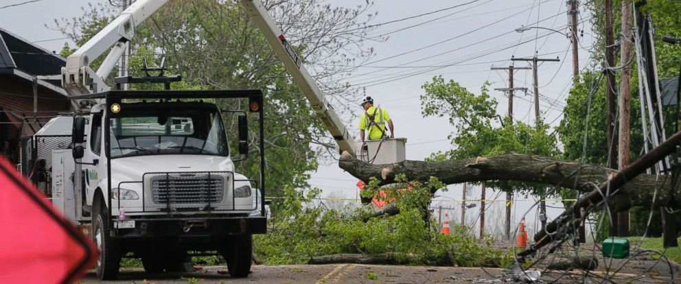 PHOTO: A utility crew works to clear a roadway of storm debris in Newburgh, N.Y., May 16, 2018.