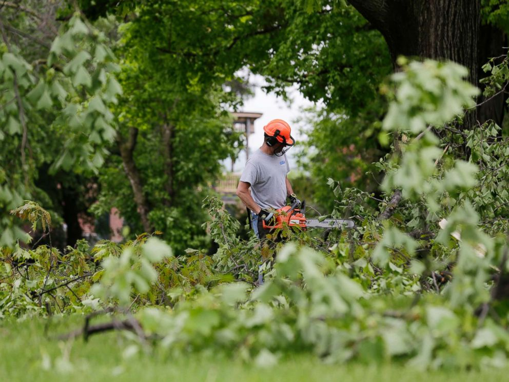 PHOTO: A man clears downed branches and debris on the grounds of Washingtons Headquarters State Historic Site in Newburgh, N.Y., May 16, 2018.