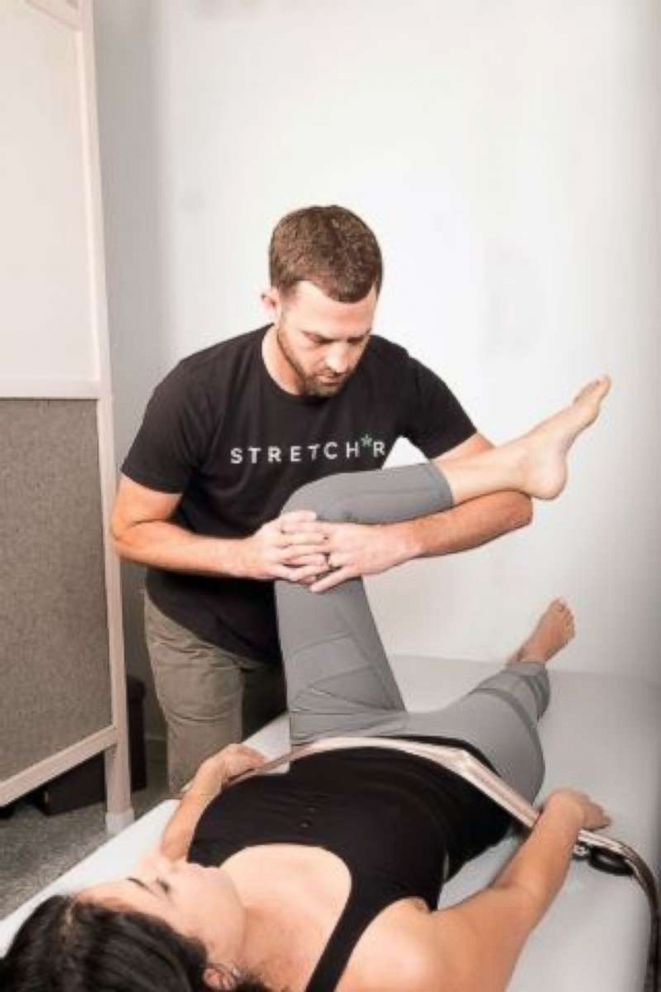 PHOTO: A Stretch*r working with a client.