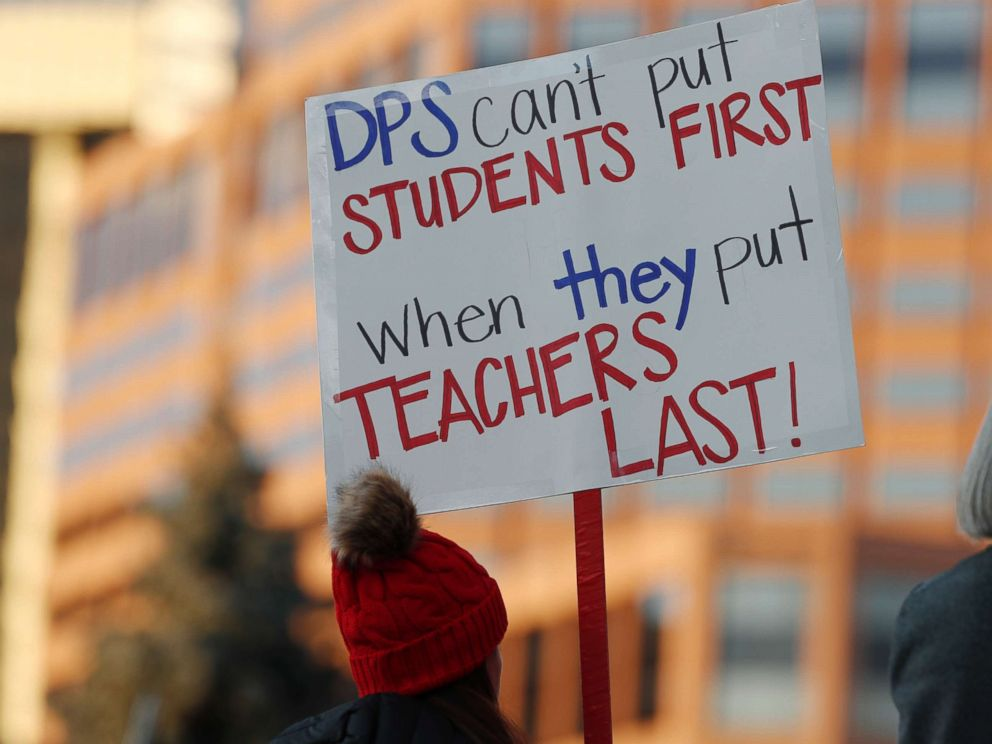 PHOTO: A teacher holds a placard during a rally by teachers from the Denver Public Schools outside the State Capitol, Jan. 30, 2019, in Denver.