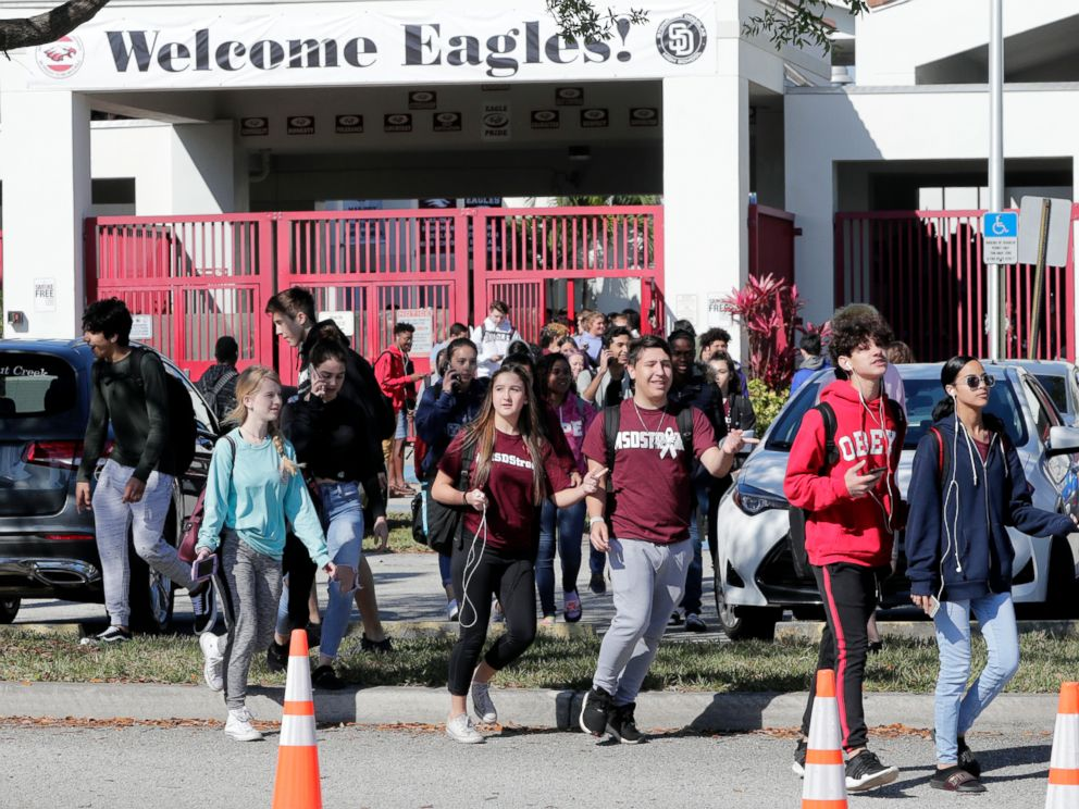 PHOTO: Students walk out of Marjory Stoneman Douglas High School, as part of a nationwide protest against gun violence, March 14, 2018, in Parkland, Fla.