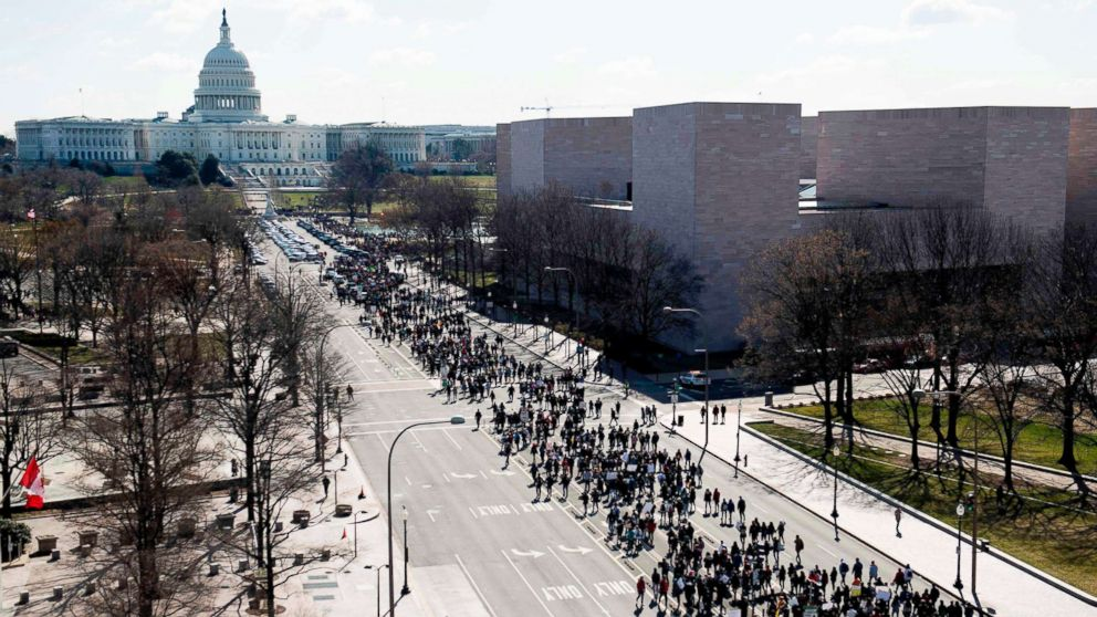 Thousands of local students march down Pennsylvania Avenue to the U.S. Capitol during a nationwide student walkout for gun control in Washington, D.C., March 14, 2018.