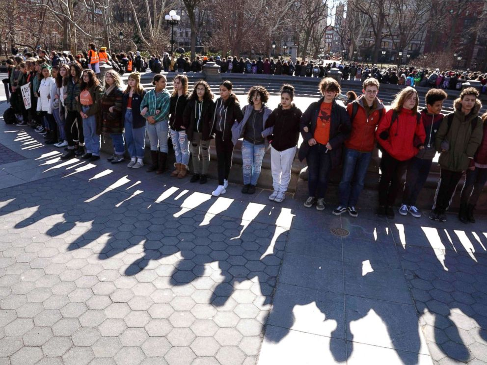 PHOTO: Students from Harvest Collegiate High School form a circle around the fountain in Washington Square Park, March 14, 2018, in N.Y. to take part in a national walkout to protest gun violence.