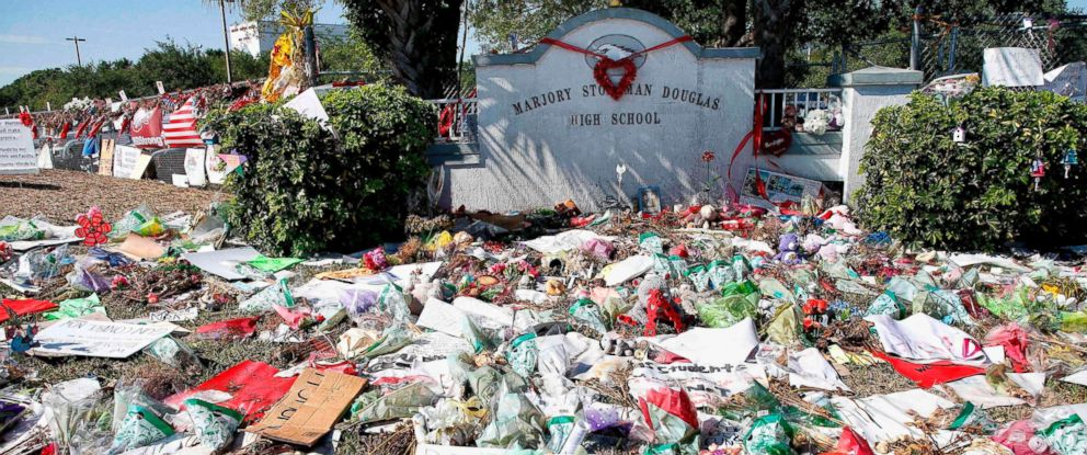 PHOTO: A general view of the makeshift memorial in front of Marjory Stoneman Douglas High School as staff, teachers and students walk out of classes to protest gun violence in Parkland, Fla. March 14, 2018.
