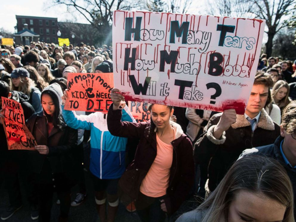 PHOTO: A student holds a sign at Georgetown University in Washington, D.C., March 14, 2018, during a National Walkout to protest gun violence, one month after the school shooting in Parkland, Fla., in which 17 people were killed.