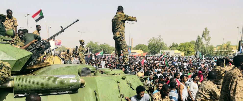 PHOTO: Sudanese soldiers stand guard on armoured military vehicles as demonstrators continue their protest against the regime near the army headquarters in Khartoum, Sudan, April 11, 2019.