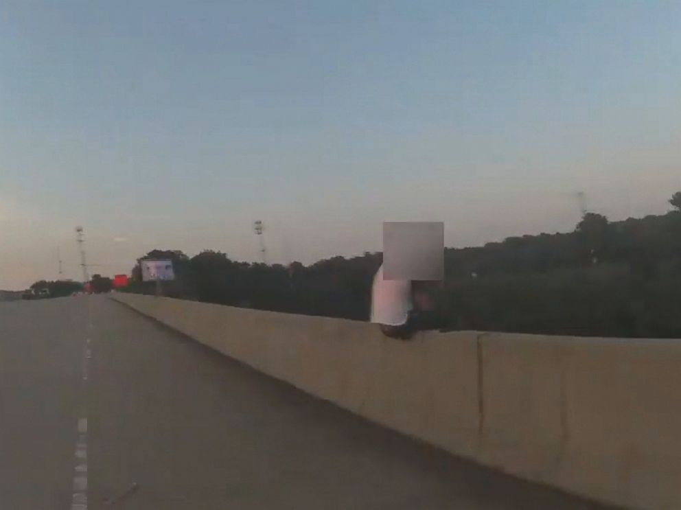 PHOTO: York-Poquoson Sheriffs Deputy James Robinson was called to the scene of a suicidal man sitting on the ledge of a highway overpass in Yorktown, Virginia.