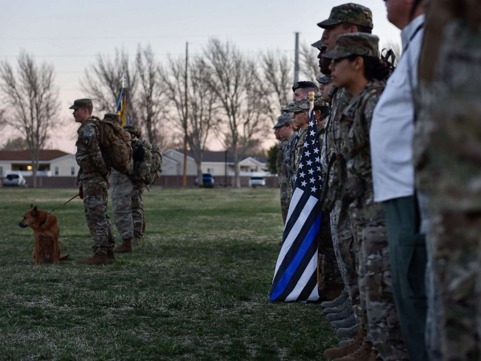 PHOTO: Participants of the 2019 377th Security Forces Squadron Suicide Awareness Ruck March stand in formation at Kirtland Air Force Base, N.M., March 29, 2019.