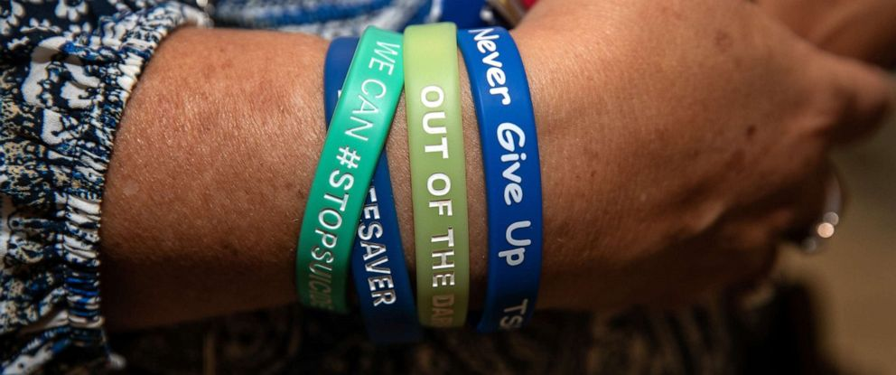 PHOTO: A woman wears suicide prevention wristbands, June 12, 2019, in Washington, DC.