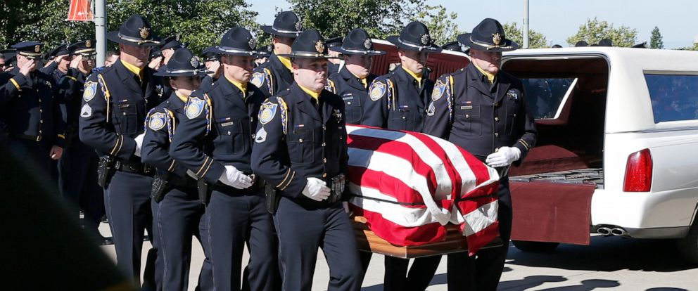 PHOTO: The flag draped casket of Sacramento Police Officer Tara OSullivan is carried into the Bayside Adventure Church for memorial services in Roseville, Calif., June 27, 2019.