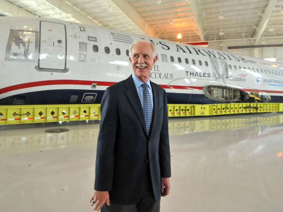 PHOTO: Capt. Chesley Sullenberger, stands in front of the US Airways flight 1549 fuselage at the Carolinas Aviation Museum, June 11, 2011.