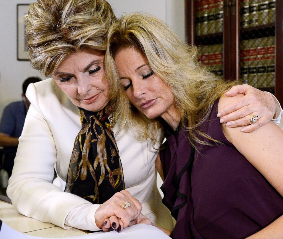 PHOTO: Summer Zervos, a former contestant on The Apprentice, is embraced by lawyer Gloria Allred while speaking about allegations of sexual misconduct against Donald Trump during a news conference in Los Angeles, Oct. 14, 2016.