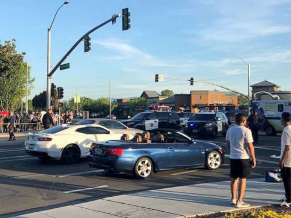 PHOTO: A woman who was hit by a driver in Sunnyvale, California, on April 23 was tossed in the air and landed right in front of the blue BMW convertible while it was stopped at an intersection, according to a witness.