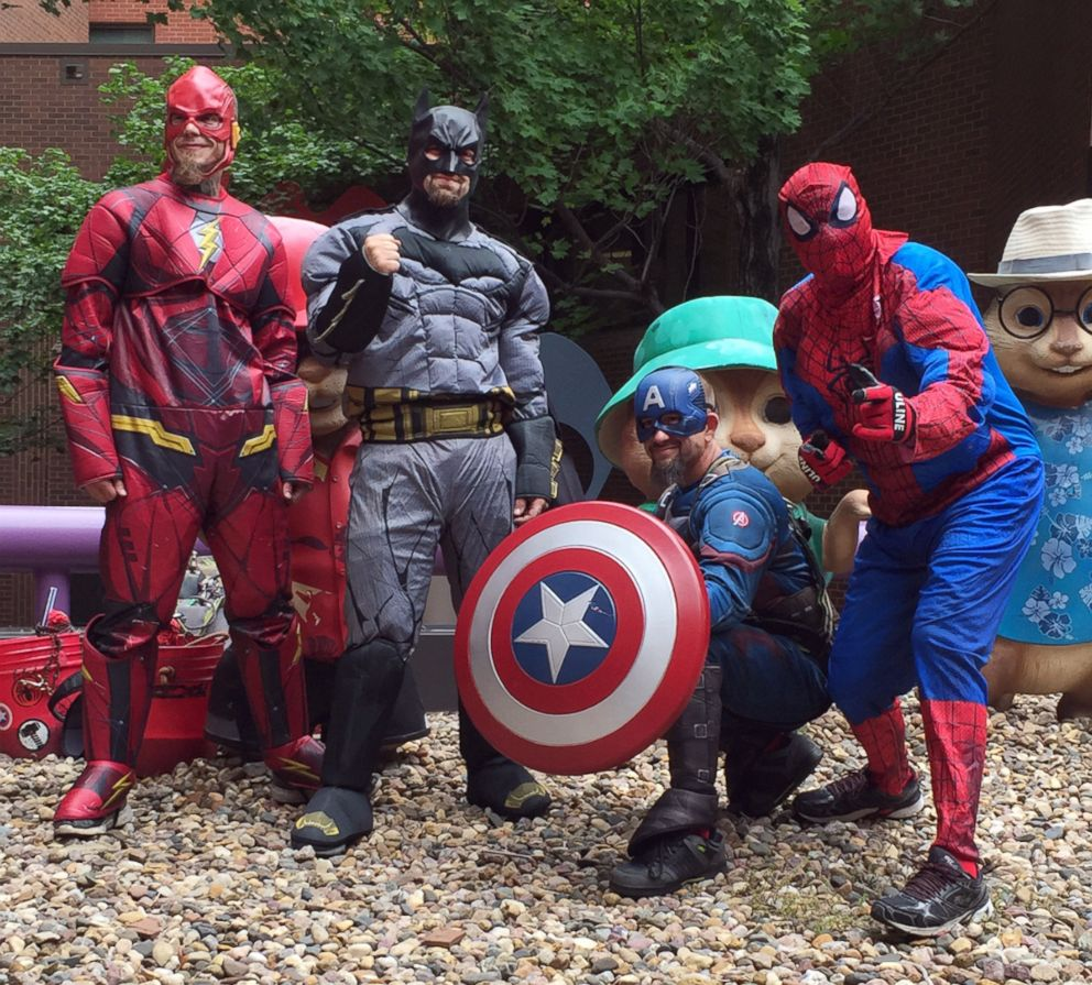 PHOTO: A team from Larrys Window Cleaning Service works in superhero costumes at Blank Childrens Hospital in Des Moines, Iowa, to surprise some little patients, June 26, 2018.