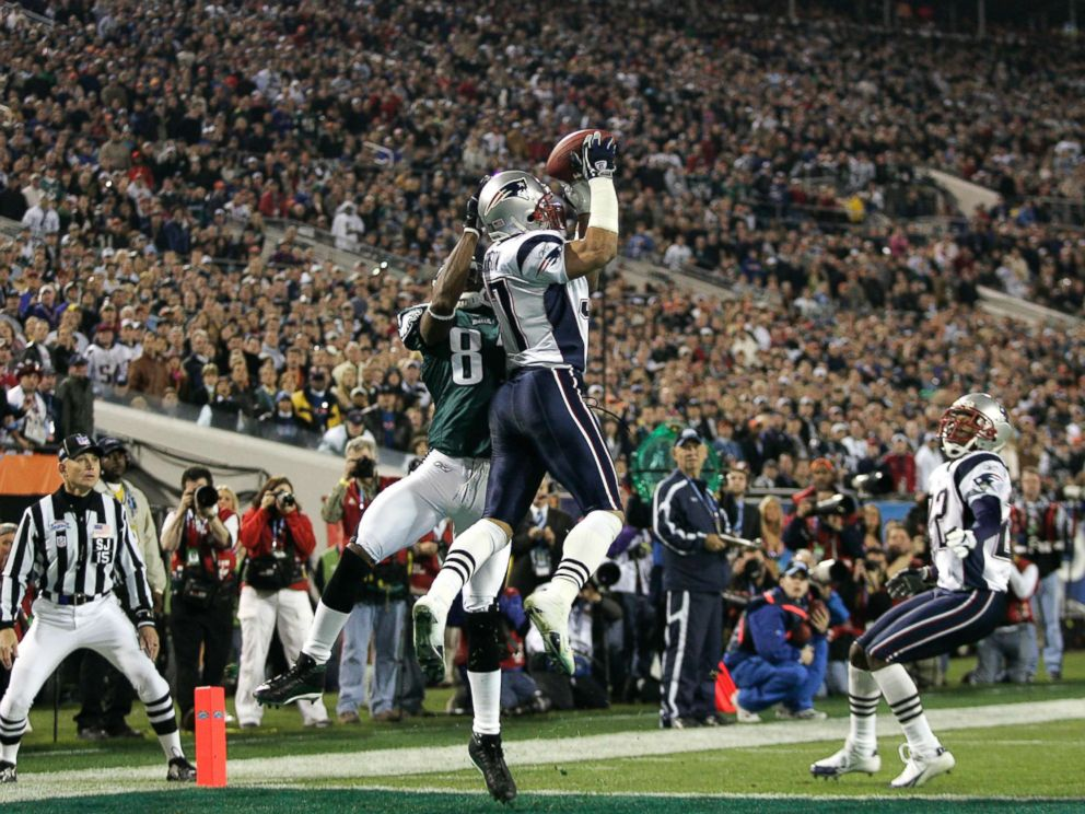 PHOTO: New England Patriots Rodney Harrison leaps in the air on an attempted interception during the NFL Super Bowl XXXIX football game against the Philadelphia Eagles in Jacksonville, Fla. Feb. 6, 2005.