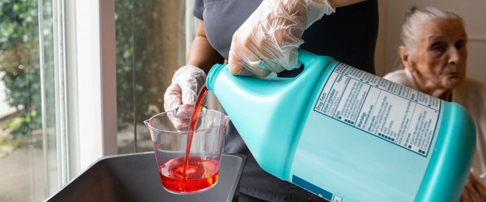 PHOTO: Certified nursing assistant Cristina Zainos prepares a special wash using antimicrobial soap.