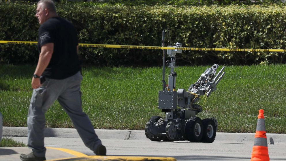 The Broward Sheriff's Office bomb squad deploys a robotic vehicle to investigate a suspicious package in the building where Rep. Debbie Wasserman Schultz has an office, Oct. 24, 2018, in Sunrise, Fla.