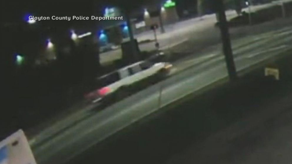 Surveillance video shows Kelsey Quayle's car headed west on a road in the Atlanta suburb of Riverdale before it suddenly drifted into on-coming traffic and hit two cars head-on. Doctors later found a bullet in the aspiring fashion model's neck.