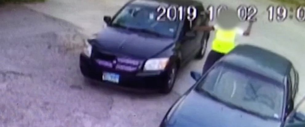 PHOTO: Surveillance footage captured a man smashing car windows with a tire iron in a liquor store attack after a parking lot crash in Houston.