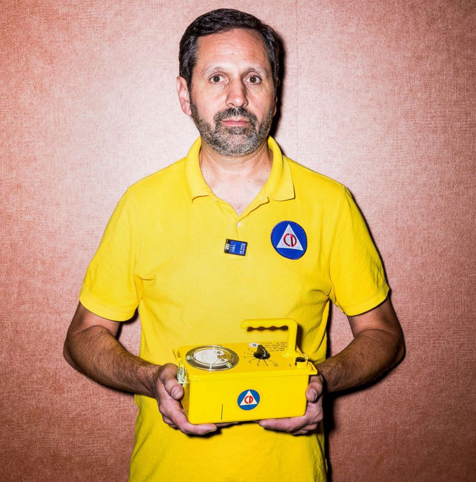 PHOTO: Craig Douglas holds a radiological survey meters, also known as as Geiger counter, at the expo