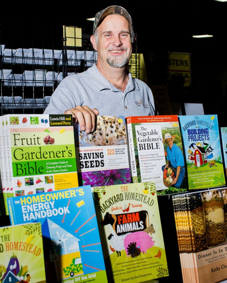 PHOTO: Mike Nocks stands behind a collection of books on display.