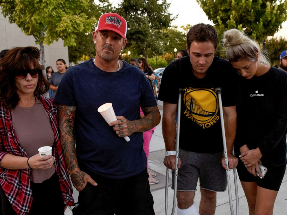 PHOTO: Survivors of the shooting at the Gilroy Garlic Festival, Shannon Gilbert, Brendon Gorshe, Nick McFarland and Sarah Ordaz, attend a vigil outside of Gilroy City Hall, in Gilroy, Calif., July 29, 2019.