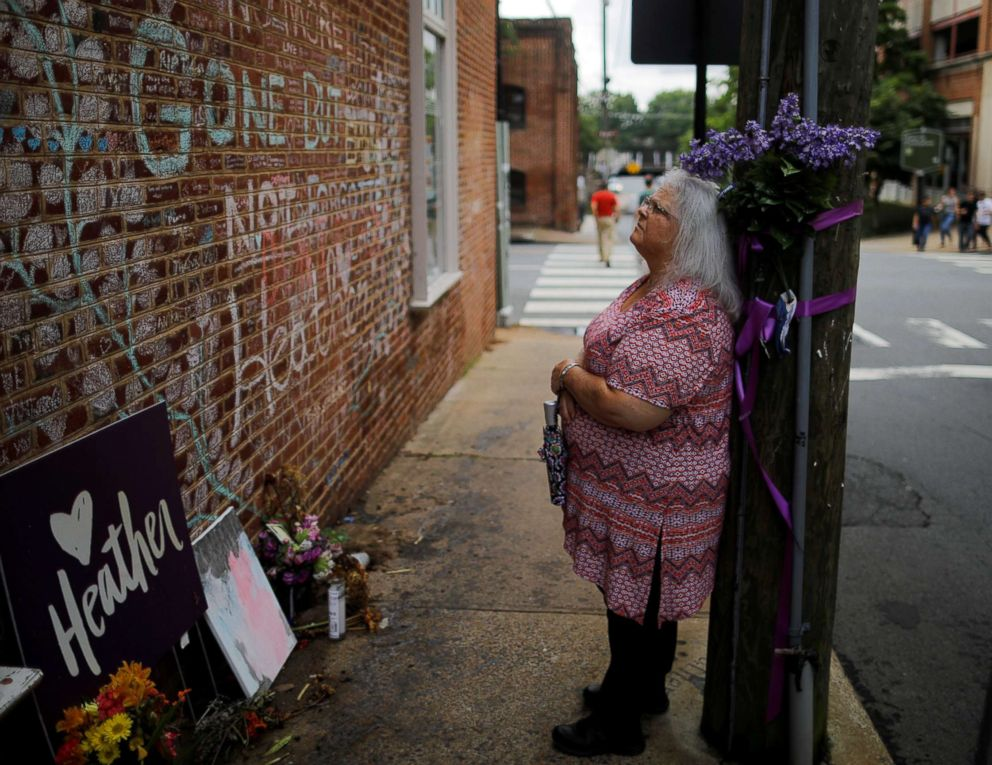 PHOTO: Susan Bro, mother of Heather Heyer, who was killed during the August 2017 white nationalist rally in Charlottesville, stands at the memorial at the site where her daughter was killed in Charlottesville, Virginia, July 31, 2018.