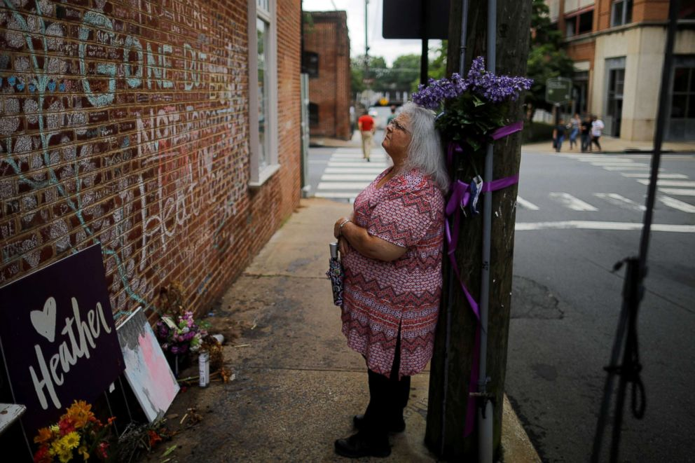 PHOTO: Susan Bro, mother of Heather Heyer, who was killed during the August 2017 white nationalist rally in Charlottesville, stands at the memorial at the site where her daughter was killed in Charlottesville, Va., July 31, 2018.