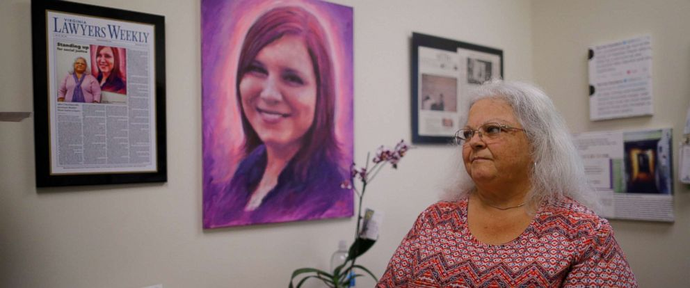 PHOTO: Susan Bro, mother of Heather Heyer, who was killed during the August 2017 white nationalist rally in Charlottesville, looks at mementos of her daughter in her office in Charlottesville, Virginia, July 31, 2018.