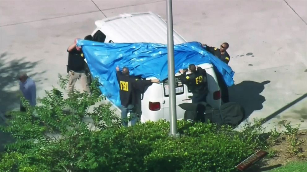 In this frame grab from video provided by WPLG-TV FBI agents cover a van parked in Plantation Fla. Oct. 26 2018 of a suspect in the mass bomb mailings