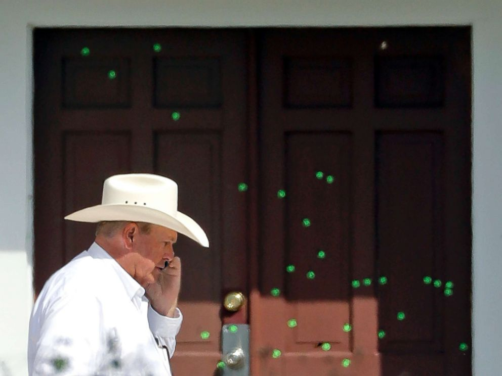 PHOTO: Wilson County Sheriff Joe Tackitt Jr. walks past the front doors where bullet holes were marked by police at the First Baptist Church, Tuesday, Nov. 7, 2017, in Sutherland Springs, Texas.