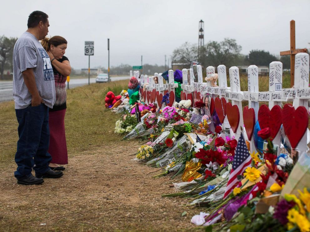 PHOTO: People visit the makeshift memorial near the First Baptist Church in Sutherland Springs, Texas, Nov. 12, 2017, honoring the 25 people including a pregnant woman whose unborn baby also died on Nov. 5, 2017.