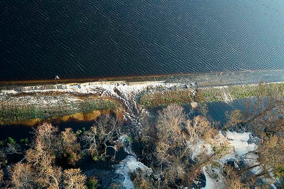 PHOTO: Gray material that Duke Energy characterized as lightweight coal combustion byproducts are seen floating on the top of the lake, near Wilmington, N.C., in a photo released by Duke Energy, Sept. 21, 2018.