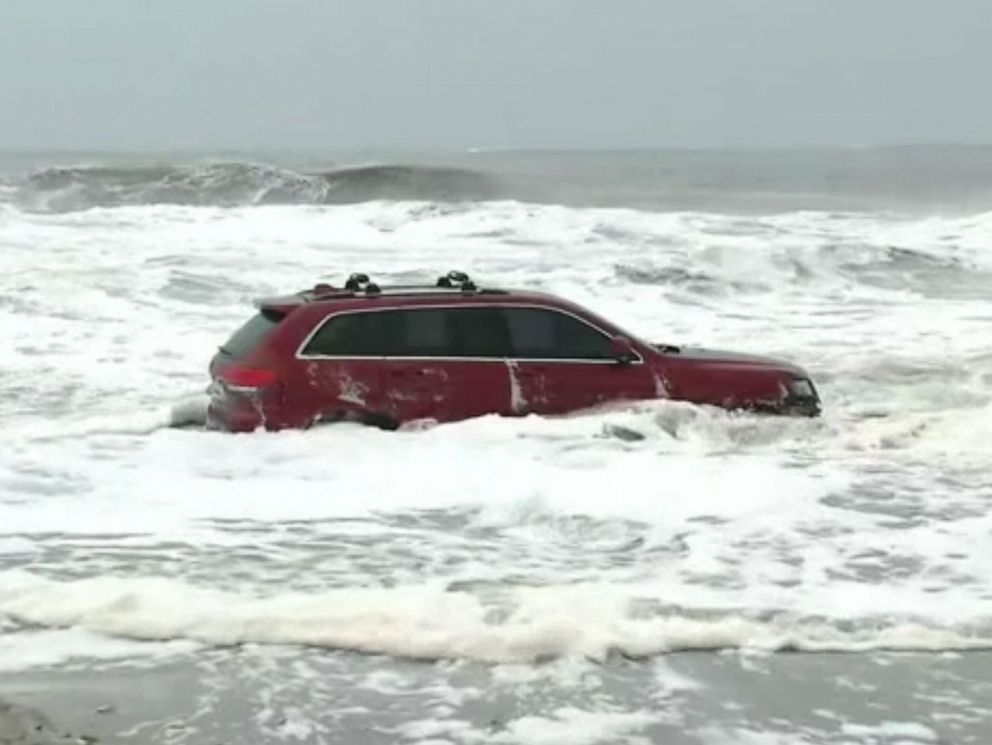 PHOTO: A Jeep is stuck in the surf at Myrtle Beach, S.C. as Hurricane Dorian hits the Carolinas.