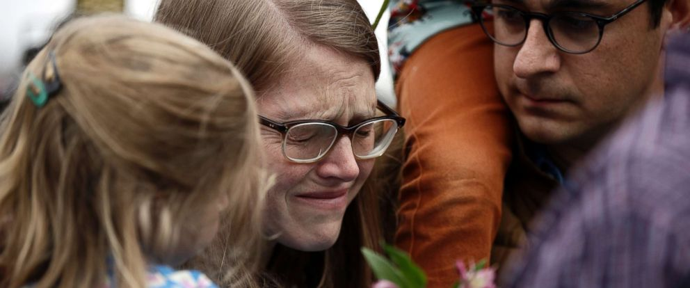 PHOTO: A woman cries as she waits to place flowers at the Tree of Life Synagogue in Pittsburgh, Oct. 28, 2018.