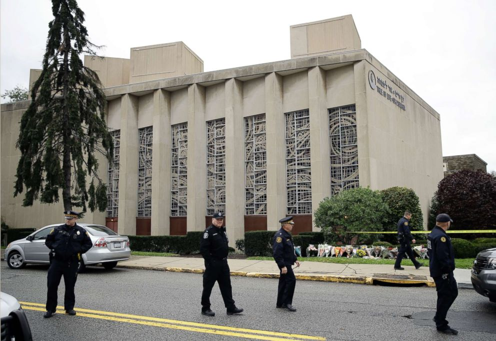 Law enforcement are positioned outside the Tree of Life Synagogue in Pittsburgh, Oct. 28, 2018.