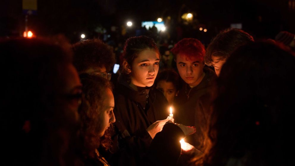 People gather for a interfaith candlelight vigil a few blocks away from the site of a mass shooting at the Tree of Life Synagogue, Oct. 27, 2018, in Pittsburgh.