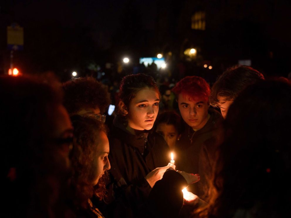 PHOTO: People gather for a interfaith candlelight vigil a few blocks away from the site of a mass shooting at the Tree of Life Synagogue, Oct. 27, 2018, in Pittsburgh.