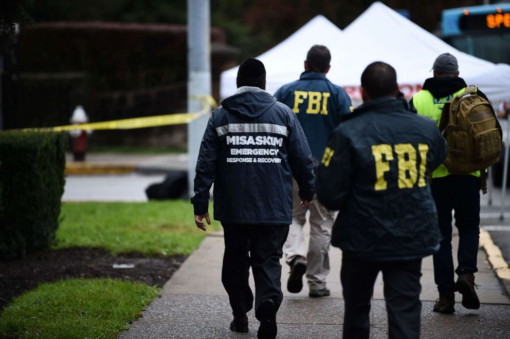 PHOTO: Members of the FBI and others survey the area, Oct. 28, 2018, outside the Tree of Life Synagogue after a fatal shooting in Pittsburgh.