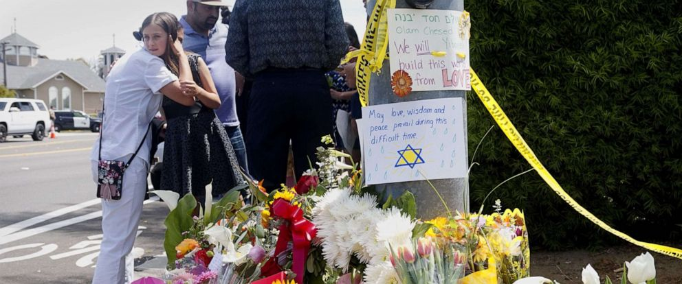 PHOTO: Mourners and well wishers leave flowers and signs at a make-shift memorial across the street from the Chabad of Poway Synagogue, April 28, 2019 in Poway, Calif., one day after a gunman opened fire, killing one person and injuring three others.