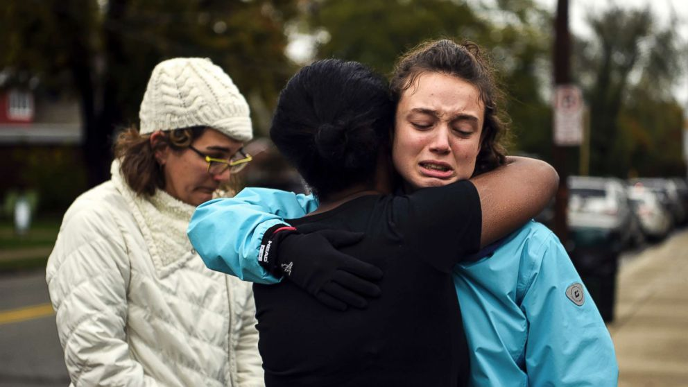 From left, Kate Rothstein looks on as Tammy Hepps hugs Simone Rothstein, after multiple people were shot at The Tree of Life Congregation synagogue, Oct, 27, 2018, in Pittsburgh.